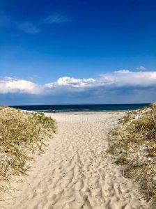 Ocean in between dunes at Hampton Beach State Park Hampton, NH.